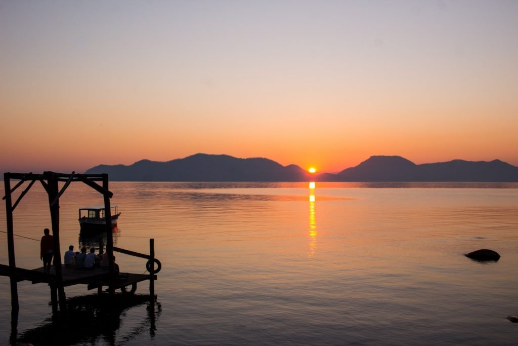 Sustainable travel - a quiet sunrise at Mumbo Island eco camp on Lake Malawi