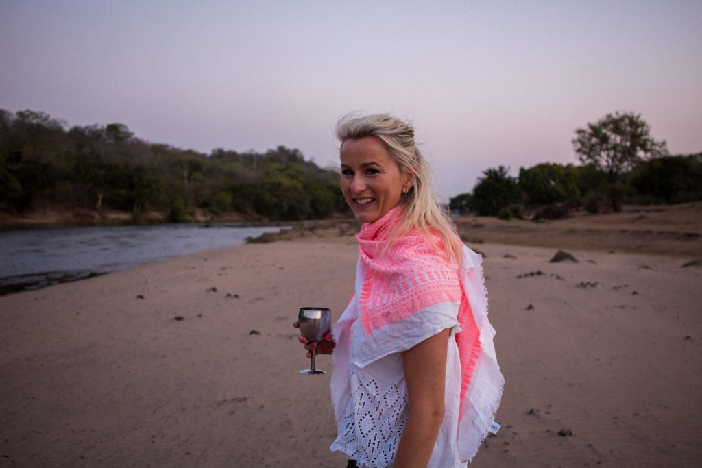 Harriet enjoying sundowners on safari at Mkulumadzi in Majete National Park, Malawi