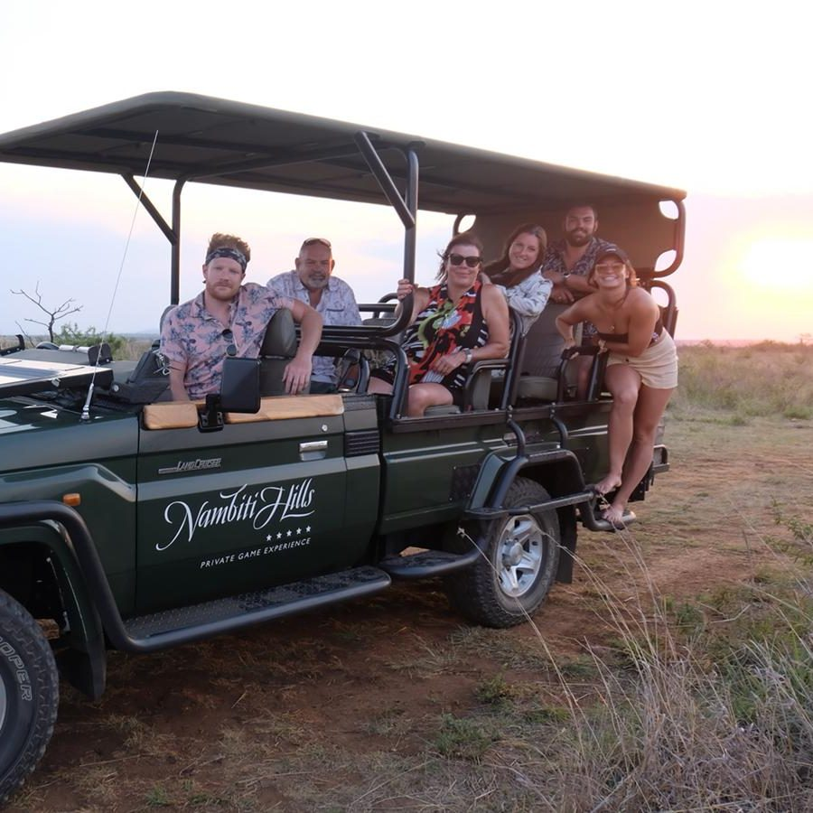 Enjoying sundowners whilst on safari at Nambiti Hills in Ladysmith, South Africa. Perfect for an affordable luxury safari