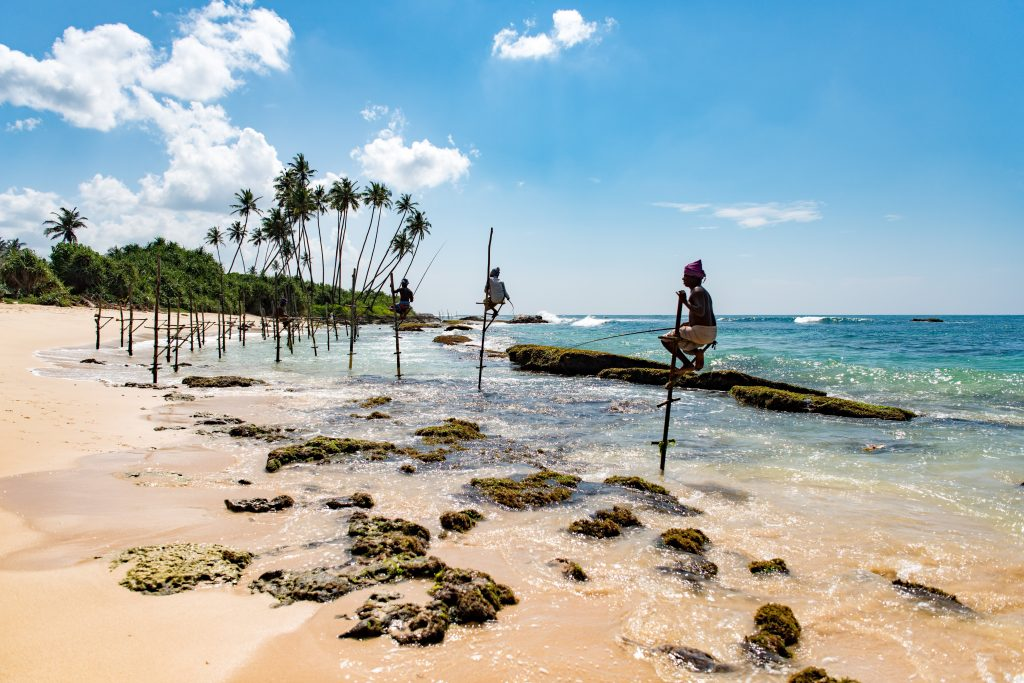 Stilt fisherman at Mirissa beach in Sri Lanka
