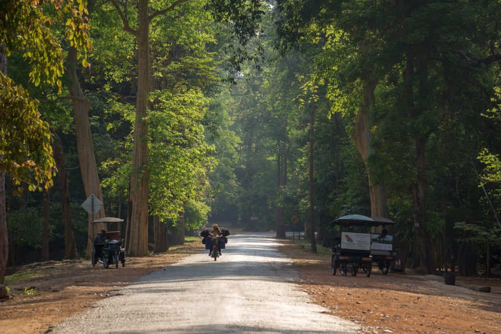 Man riding motorbike near Angkor Wat in Siem Reap Cambodia